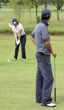 Couple of golfers Royalty Free Stock Photos