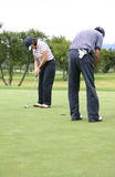 Couple of golfers 2 Royalty Free Stock Images
