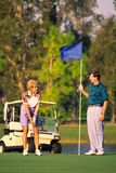 Couple Golfing 2. Couple Golfing on green putting royalty free stock photos