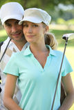 Couple golfing Royalty Free Stock Photo