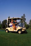 Couple Golfing 3. Couple Golfing in golf cart with scorecard royalty free stock images