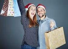Couple got some present bags Royalty Free Stock Image