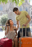 Couple with GPS navigator and baggage Royalty Free Stock Photography