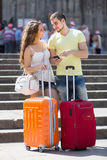 Couple with GPS navigator and baggage Royalty Free Stock Photos