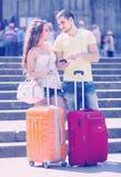 Couple with GPS navigator and baggage Stock Image