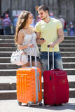 Couple with GPS navigator and baggage Stock Photos