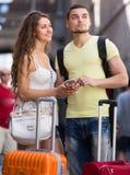 Couple with GPS navigator and baggage Stock Photography