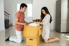 Couple grab household objects from box royalty free stock images