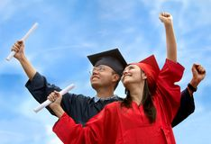 Couple of graduates outdoors Royalty Free Stock Photography