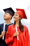 Couple of graduates outdoors Royalty Free Stock Photo