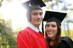 Couple at Graduation. Couple in caps and gowns outside for college graduation stock photo