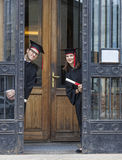 Couple in the Graduation Day. Young couple in the graduation day having fun at the gate of the University Stock Image