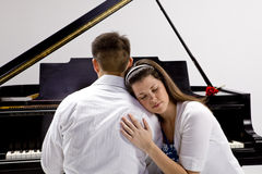 Couple with Grand piano 4 Royalty Free Stock Photo