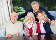 Couple With Grandparents At Nursing Home Stock Photos