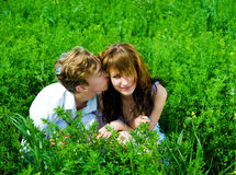 Couple in grass Stock Image