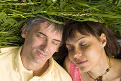 Couple on grass Royalty Free Stock Photography