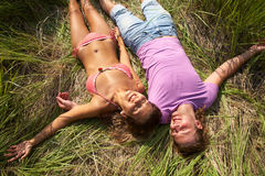 Couple  in the grass Stock Images
