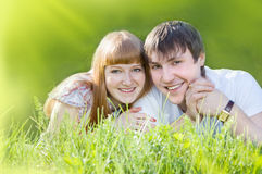 Couple on the grass Royalty Free Stock Images