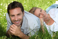 Couple in the grass Stock Photo