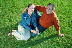 Couple on Grass. A couple sitting in the grass Royalty Free Stock Image