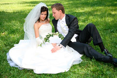 Couple on the grass Royalty Free Stock Photos