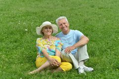 Couple on grass Royalty Free Stock Images