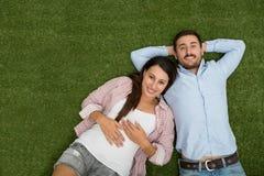 Couple on the grass stock photos