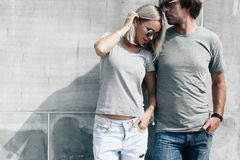 Couple in gray t-shirt over street wall Stock Image