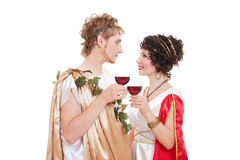 Couple in greek style with wine Royalty Free Stock Images