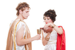 Couple in greek style with wine Royalty Free Stock Photo