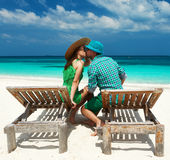 Couple in green on a beach at Maldives. Couple in green on a tropical beach at Maldives stock photos