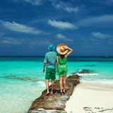 Couple in green on a beach at Maldives Stock Images