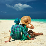 Couple in green on a beach at Maldives Royalty Free Stock Photos
