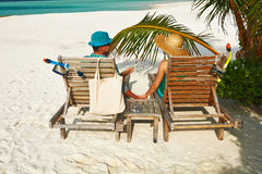 Couple in green on a beach at Maldives Royalty Free Stock Image