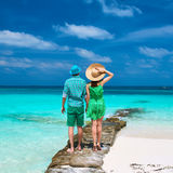Couple in green on a beach at Maldives Royalty Free Stock Photo