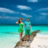 Couple in green on a beach at Maldives Stock Photo