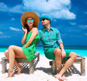 Couple in green on a beach at Maldives Royalty Free Stock Images