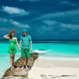 Couple in green on a beach at Maldives Stock Image