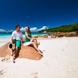 Couple in green on a beach at Seychelles Stock Images