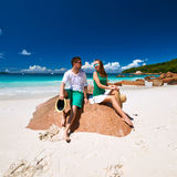 Couple in green on a beach at Seychelles Stock Photos