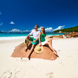 Couple in green on a beach at Seychelles Stock Photo