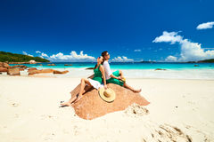 Couple in green on a beach at Seychelles Royalty Free Stock Photo