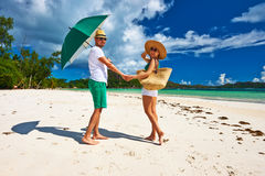 Couple in green on a beach at Seychelles royalty free stock photography