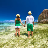 Couple in green on a beach at Seychelles Royalty Free Stock Image