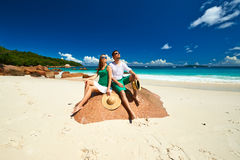 Couple in green on a beach at Seychelles Royalty Free Stock Images