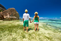 Couple in green on a beach at Seychelles Stock Image
