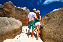 Couple in green on a beach at Seychelles Royalty Free Stock Photos
