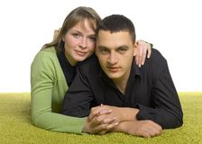 Couple on the green carpet Royalty Free Stock Photography