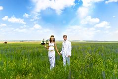 Couple on the green field Royalty Free Stock Photos