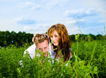 Couple in a green grass Stock Images